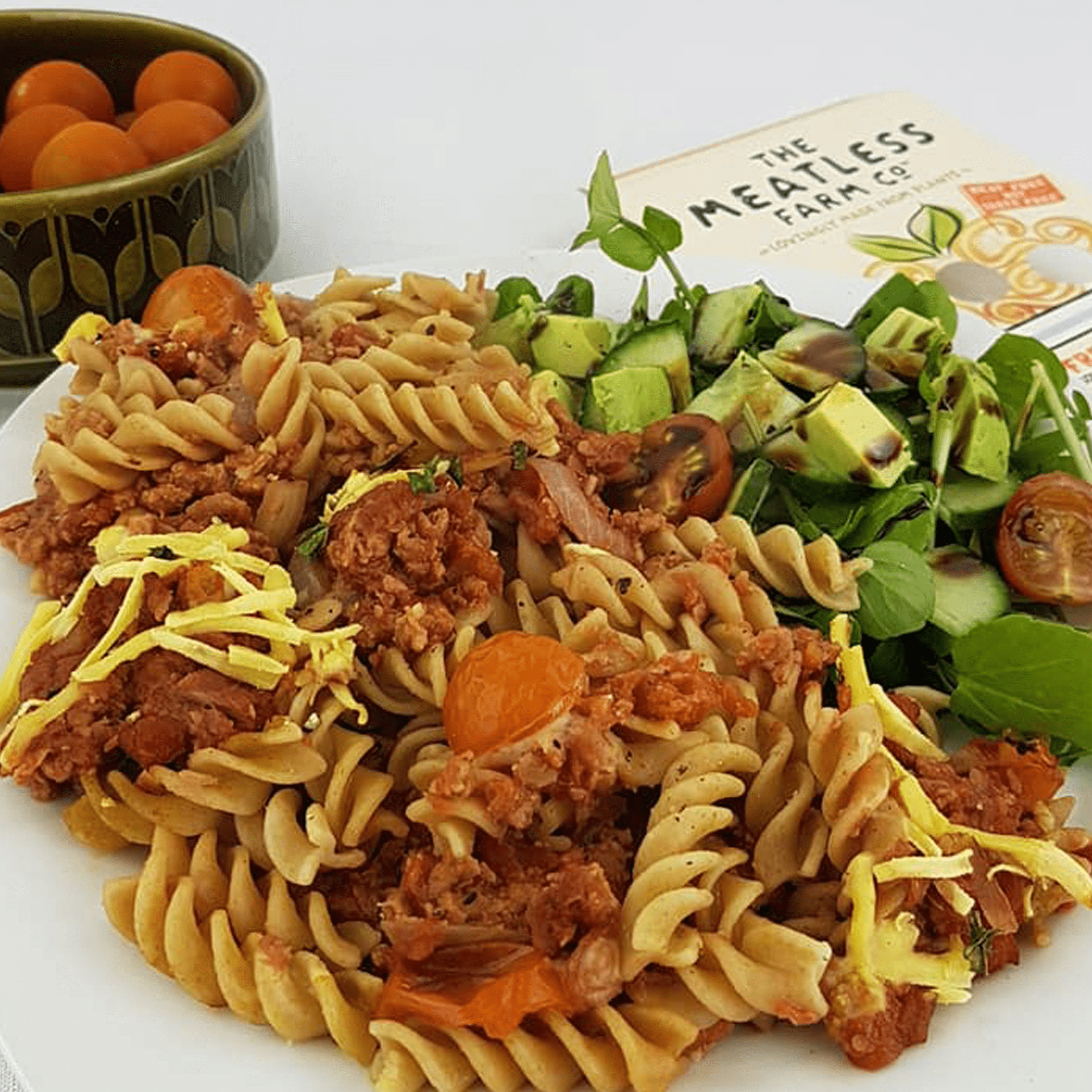Pasta with meatless mince and avocado salad